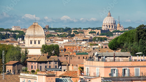 Papiers peints Rome Sunny roofs of Rome and Saint Peters basilica in Vatican, Italy