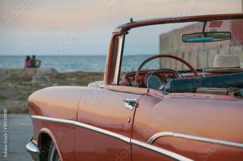 Foto op Canvas Havana Classic American car in Havana in front of the sea. Cuba
