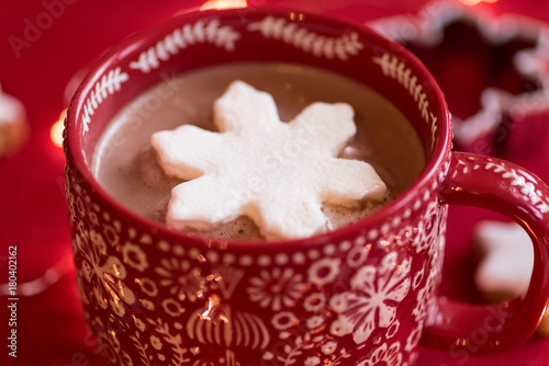 Foto op Canvas Chocolade Closeup of festive winter mug of hot chocolate with pretty snowflake shaped marshmallow