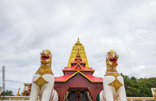 Fotobehang Thailand Golden Puttakaya chedi(pagoda) with two giant Chinthe at the entrance,Sangkhlaburi district,Kanchanaburi,Thailand.