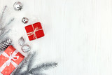 silver christmas tree branch, decorations, nuts and gift boxes  on white wooden background with copy space - 180409561