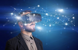 Businessman with virtual reality goggles - 180409758