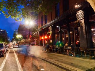 downtown night life scene people walking