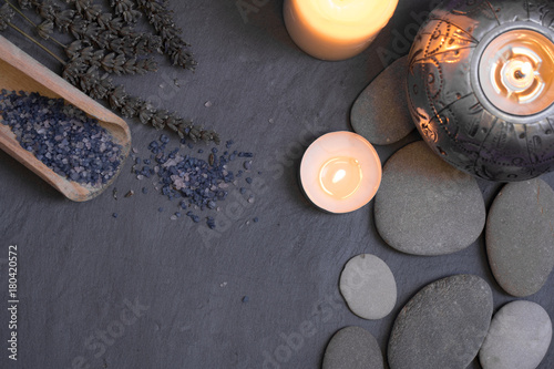 spa and wellness still life composition with candles and pebble stones