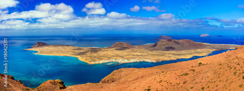 Fotobehang Freesurf Scenery of volcanic Lanzarote - panoramic view from Mirador del Rio for Graiosa island. Canary islands