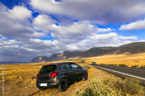 Fotobehang Freesurf Exploring volcanic Lanzarote . Rent car. Canary islands