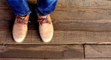 Men autumn fashion style - men standing pair of leather brown shoes and jeans top view on old wooden grunge boards.  - 180426101