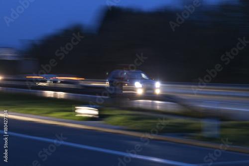 Fotobehang Nacht snelweg rainy highway traffic at night