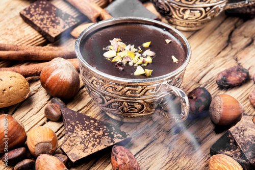 Foto op Canvas Chocolade Melting chocolate,spice and nuts