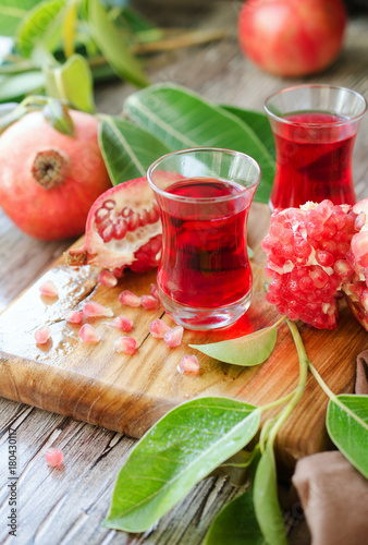 Fotobehang Sap Fresh pomegranates and juice, selective focus