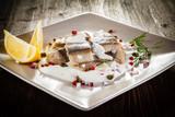 Marinated herring fillets in cream