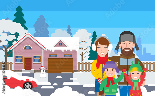 happy family standing outside house cottage in winter clothes