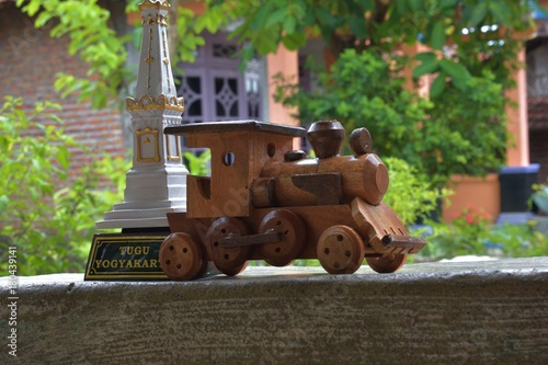 Fotobehang Trekker Miniature monument Jogja behind miniature train made of wood.