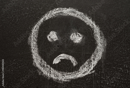 sad sign smiley, sketched with white chalk on the blackboard Poster