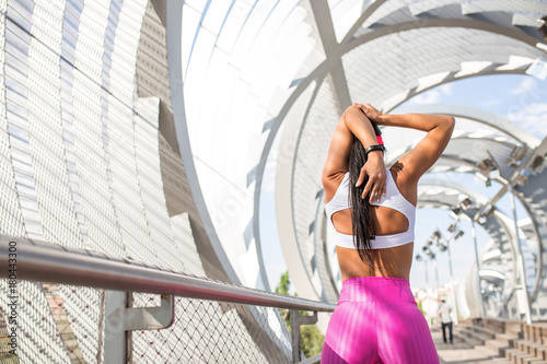 Fit woman runner stretching outdoors