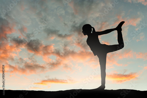 Poster Girl doing yoga excercise at sunset. Silhouette series.