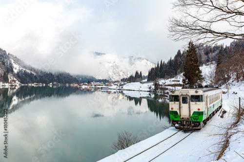 Fotobehang Bergrivier Train in Winter landscape snow