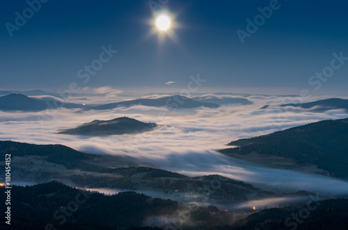 Fotobehang Nachtblauw Misty mountains panorama in the night, full moon, Poland landscape, Beskidy range