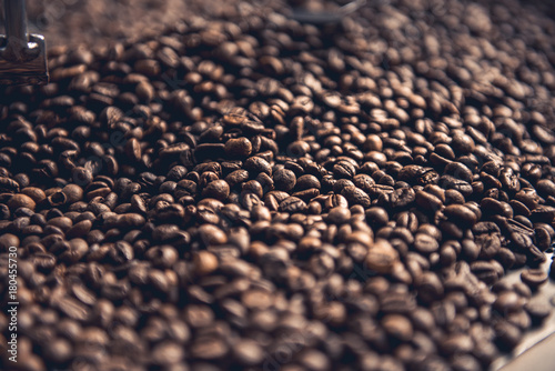 Close up brown aromatic grains situating in cooling cylinder. Preparation concept - 180455730