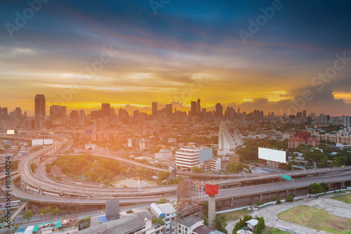 Fotobehang Tokio City office building over highway intersection with sunset sky background, cityscape background