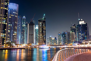 Dubai marina with skyscrapers and calm water night view