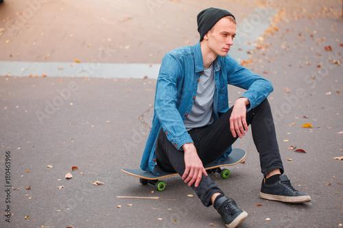 Aluminium Skateboard Closeup of a young man sitting on a skateboard