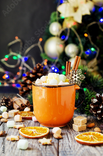 Foto op Canvas Chocolade a cup of Christmas hot cocoa with marshmallow New Year's lights and decorations, selective focus