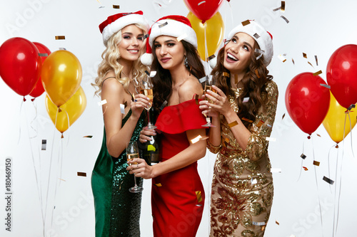 New Year's Party Time. Happy Girls Having Fun At Party.