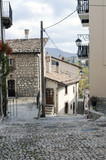 A characteristic street in the village of Pescocostanzo. National Park of Majella, Italy. - 180471760