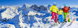 Happy family enjoying winter vacations in mountains . Ski, Sun, Snow and fun. - 180482508