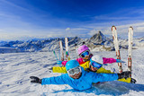 Happy family enjoying winter vacations in mountains . Ski, Sun, Snow and fun. - 180482589