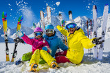 Happy family enjoying winter vacations in mountains. Playing with snow, Sun in high mountains. Winter holidays. - 180482718