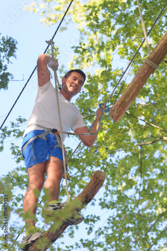 Fotobehang Amusementspark man on a tree adventure experience