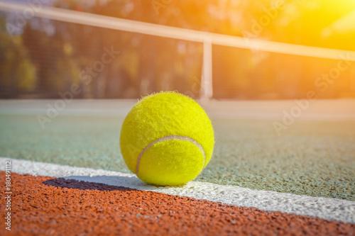 Aluminium Tennis macro tennis ball on the line on hard court. blurry net in the background