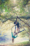two young women aerial hoop  dance in forest - 180492902
