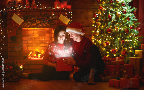 Merry Christmas! family couple with magic Christmas gift - 180493967