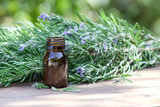 Essential rosemary oil. Herbal treatment. - 180494953