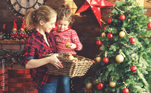 happy family mother and child girl decorated Christmas tree - 180497775