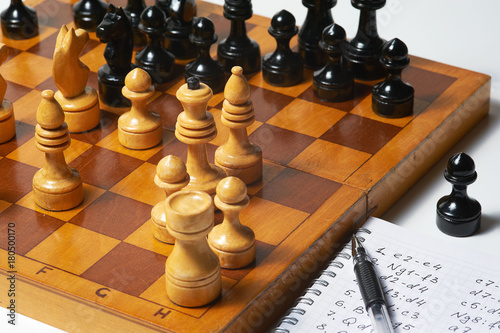Plakat Chess game, notebook with notation and pen