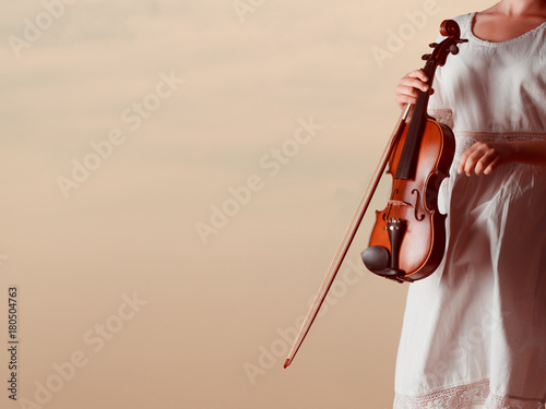 Fotobehang Muziek Musician violinist woman holding her violin