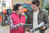 agronomist helping farmer planning the harvest - 180505517