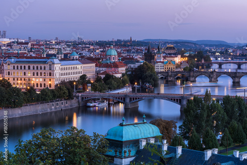 Tuinposter Praag The bridges of Prague át dawnDawn over the beautiful bridges and the embankment of the Vltava River flowing through the city center of Prague in the Czech Republic.