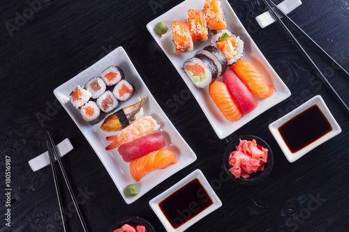 Aluminium Sushi bar Japanese sushi dish pattern on black wooden background