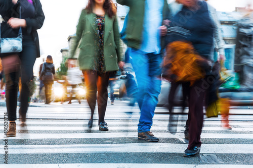 Fridge magnet crowds of people in motion blur crossing a city street