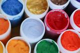 Fototapety Varieties of colors in white bottles.