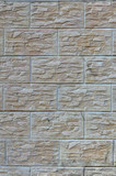 Wall of light texture tiles, stylized in appearance as a brick. One of the types of wall decoration