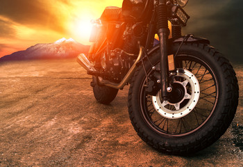 old retro motorcycle and beautiful sunset sky background