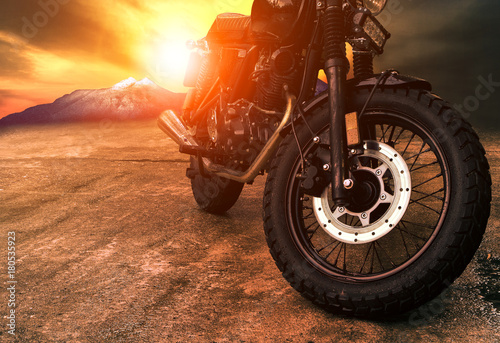 Fotobehang Fiets old retro motorcycle and beautiful sunset sky background