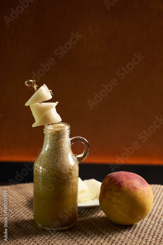 Fresh fruit smoothie with peach and melon - 180535939
