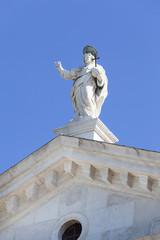 16th-century Benedictine San Giorgio Maggiore church, statue on the top, Venice, Italy.